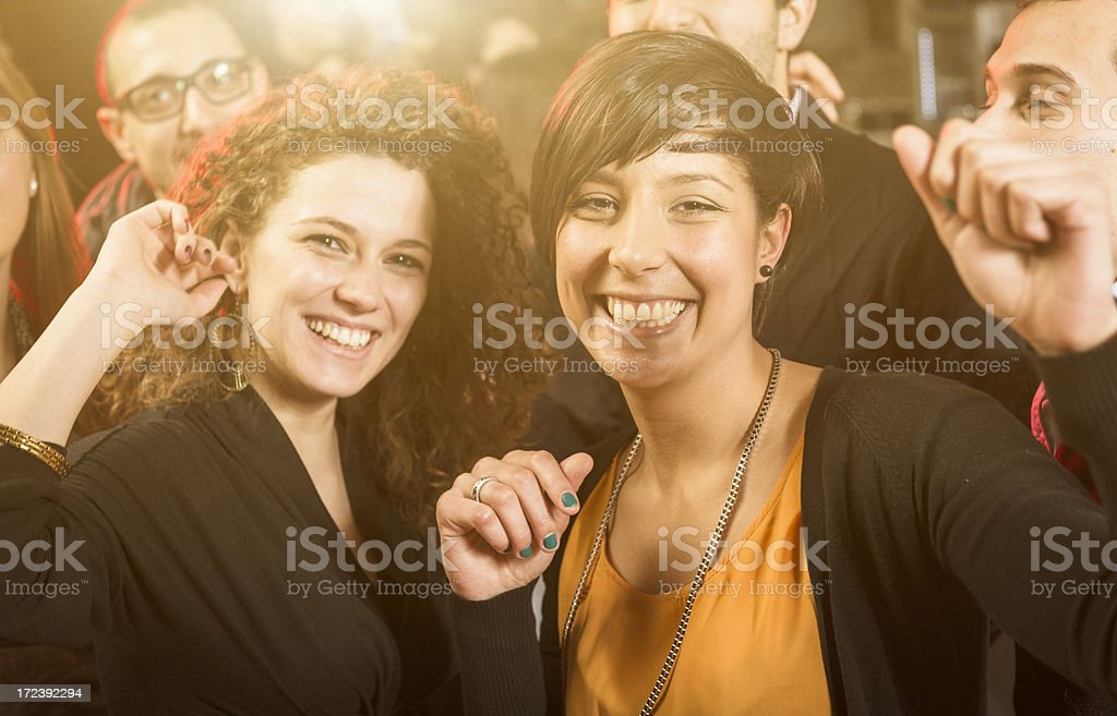 Friends dancing at the disco - all together royalty-free stock photo