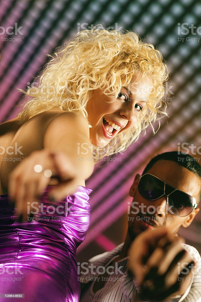 Friends dancing in club or disco royalty-free stock photo