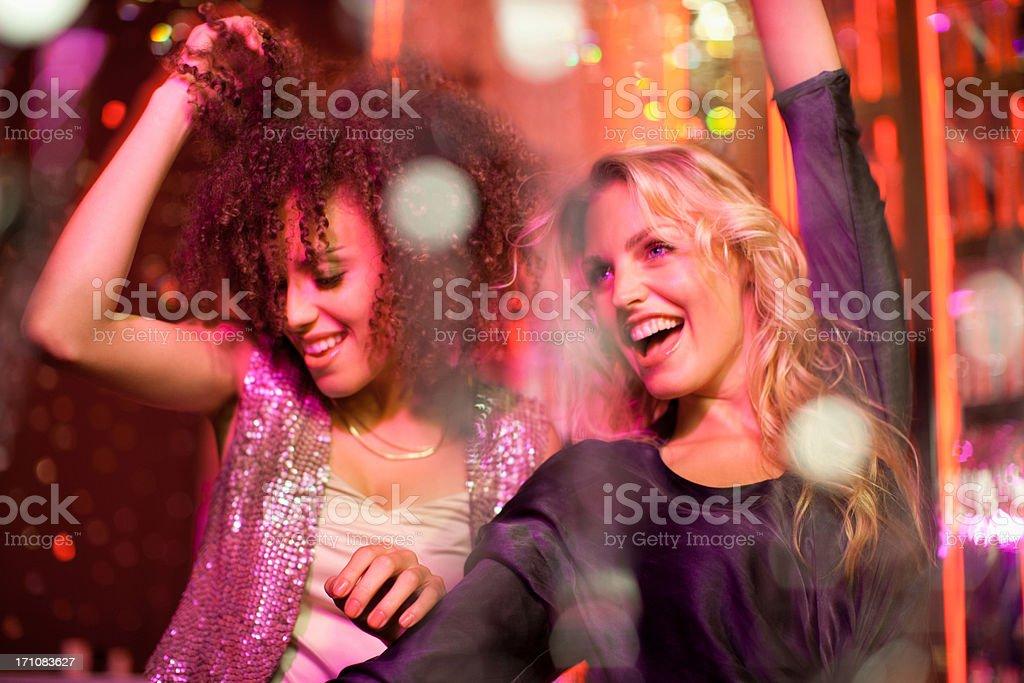 Friends dancing in nightclub stock photo