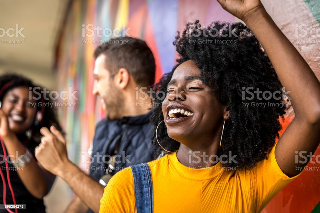 Friends dancing in the park royalty-free stock photo
