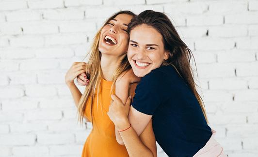 Friends dancing indoors