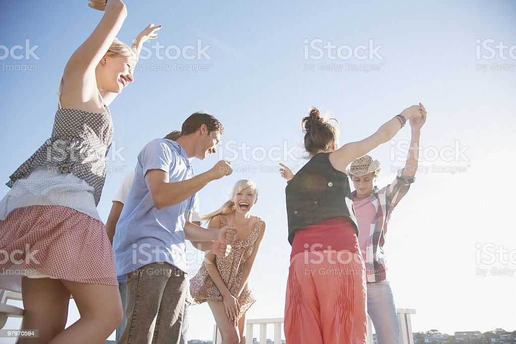 Friends dancing on rooftop royalty-free stock photo