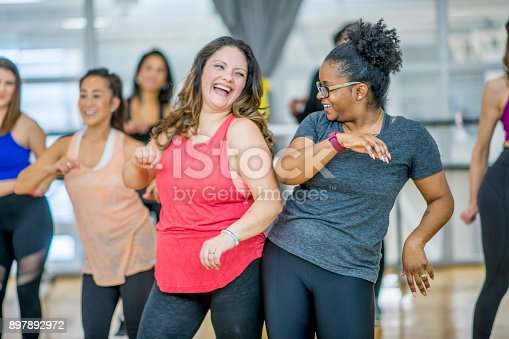 istock Friends Dancing Together 897892972