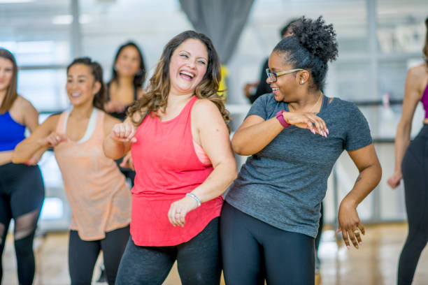 friends dancing together - health club stock photos and pictures