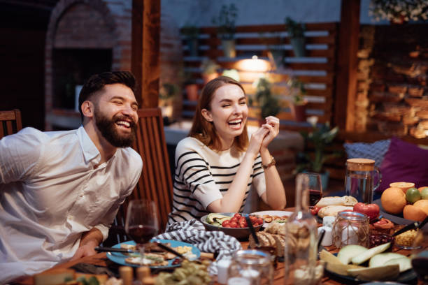 friends dining outdoor - foodie stock photos and pictures