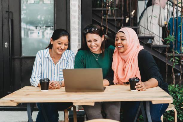 friends doing a conference call together - хиджаб стоковые фото и изображения