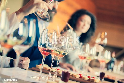 istock friends doing a wine tasting 1136060889