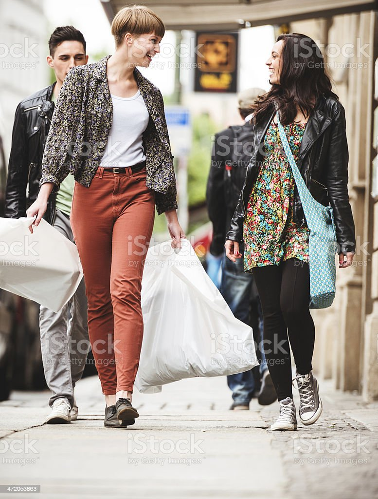 Friends doing shopping in the city stock photo