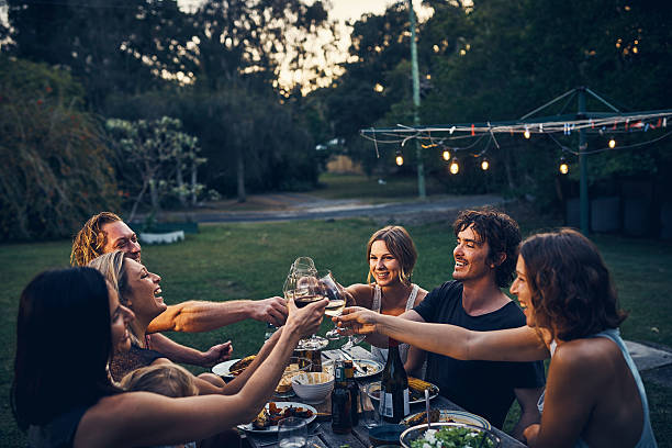 Friends don't let friends drink wine alone stock photo