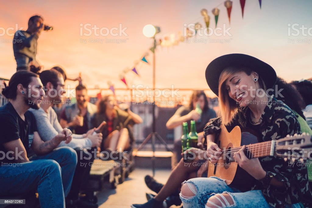 Friends drinking and partying on the rooftop stock photo