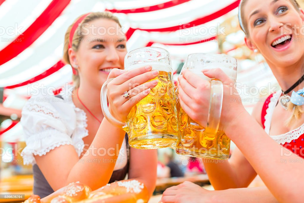 Friends drinking Bavarian beer at Oktoberfest stock photo