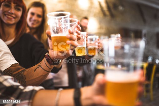 istock friends drinking beer at the oktoberfest 639271634
