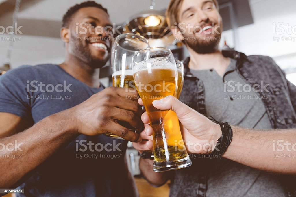 Friends drinking beer in a pub stock photo