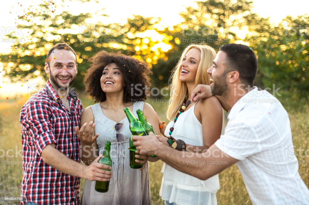 Friends drinking beer in nature royalty-free stock photo