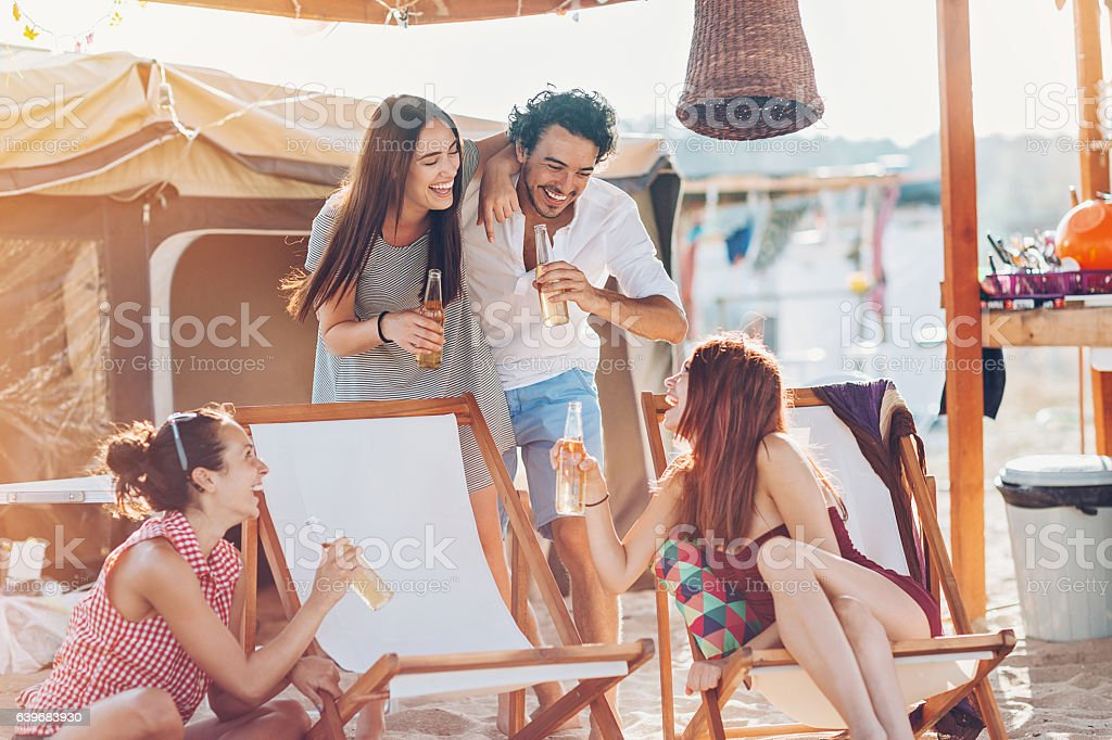 Friends drinking beer outdoors stock photo