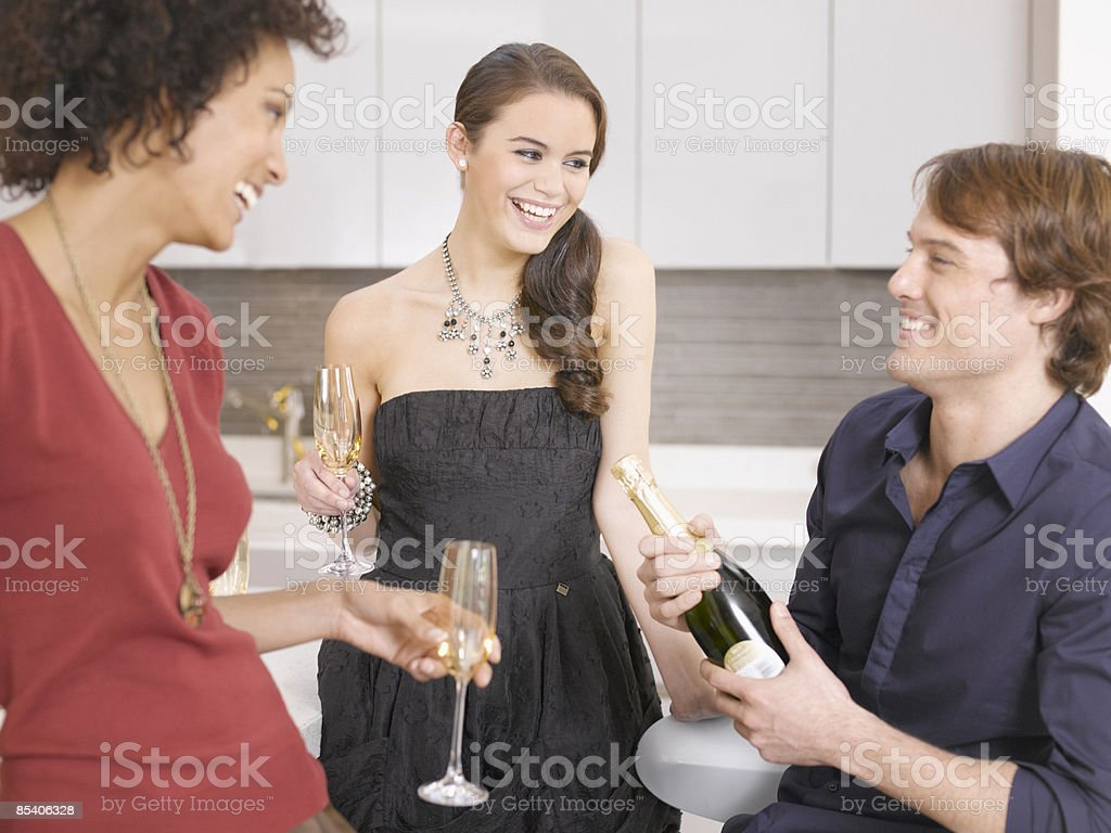 Friends drinking Champagne at party royalty-free stock photo