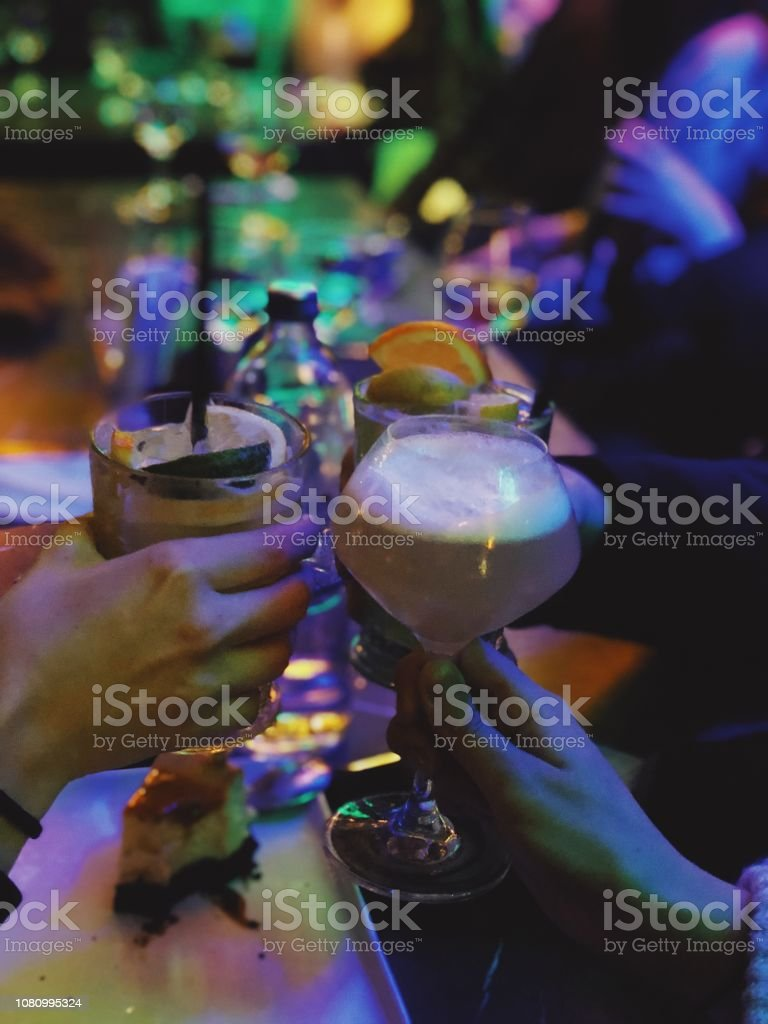 Friends drinking cocktails stock photo