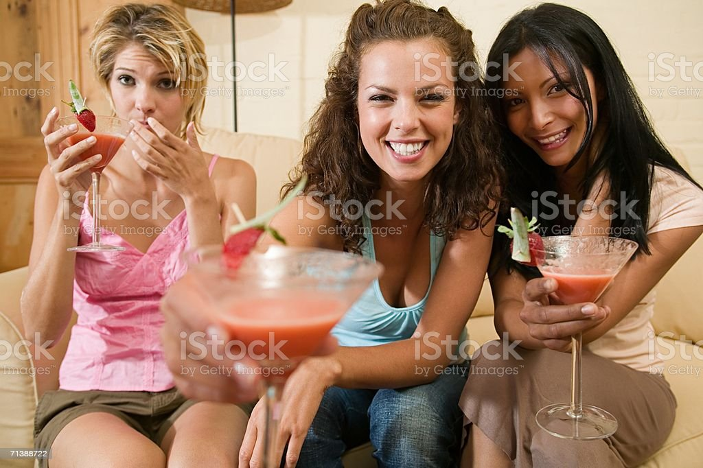 Friends drinking cocktails royalty-free stock photo