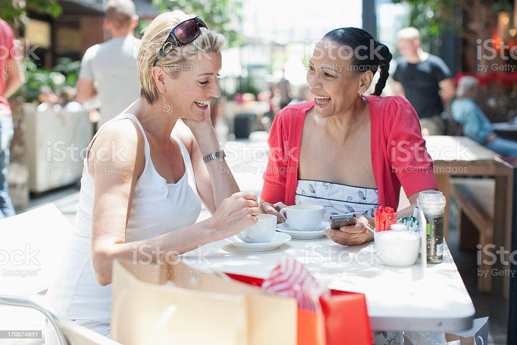 Friends drinking coffee at cafe royalty-free stock photo