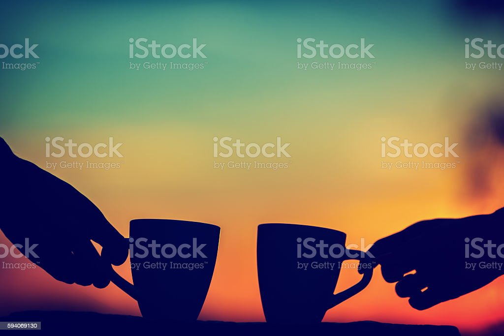 Friends drinking coffee in sunset / sunrise. stock photo