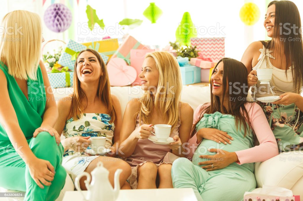 Friends drinking tea on baby shower party stock photo