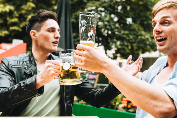 friends drinking togetherness for the oktoberfest in berlin stock photo