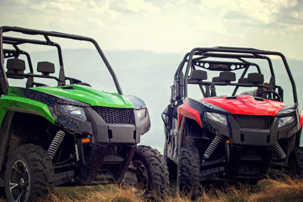 Friends driving off-road with quad bike or ATV and UTV vehicles Friends driving off-road with quad bike or ATV and UTV vehicles. quadbike stock pictures, royalty-free photos & images