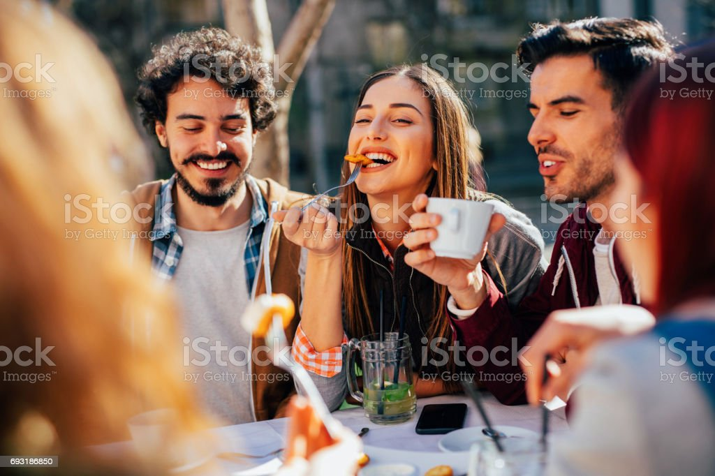 Friends eating at a restaurant stock photo