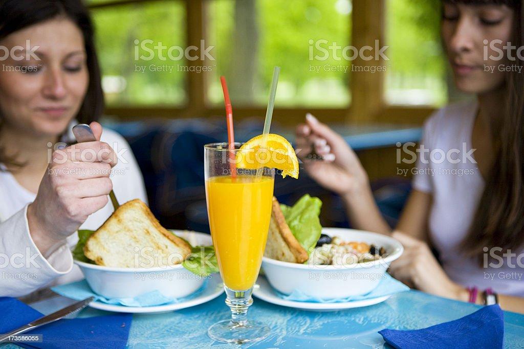 Friends eating Caesar Salad royalty-free stock photo