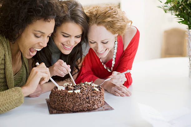 friends eating chocolate cake - genot stockfoto's en -beelden