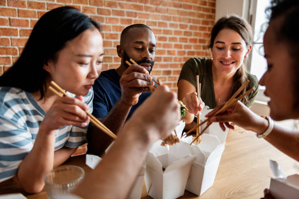 friends eating chow mein together - chinese food stock photos and pictures
