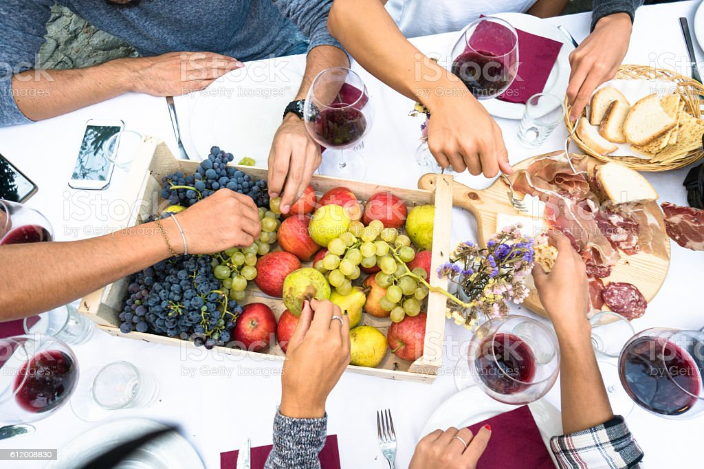 friends eating fruit from high view - Photo