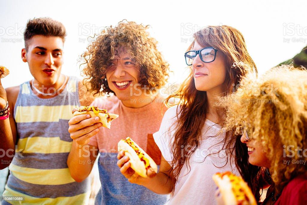 Friends Eating Hotdogs stock photo