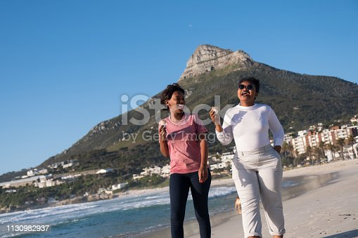 istock Friends eating ice cream at the beach 1130982937