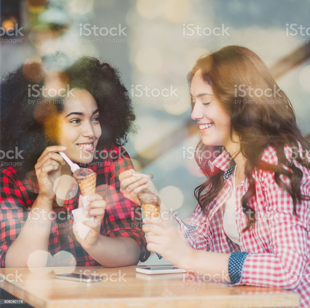 Friends eating ice-cream stock photo