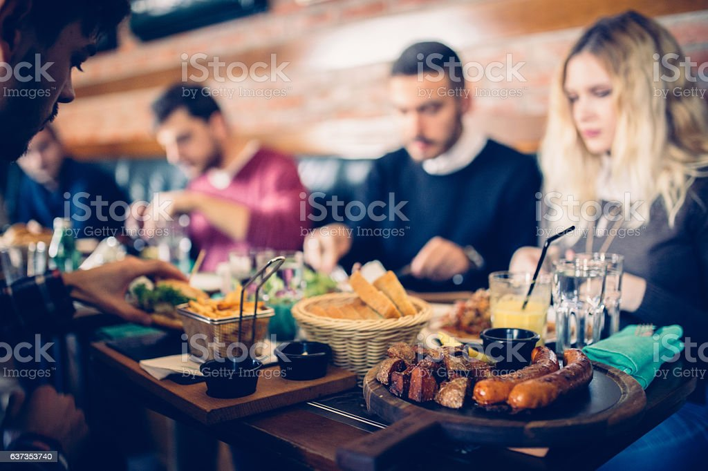 Friends eating lunch stock photo