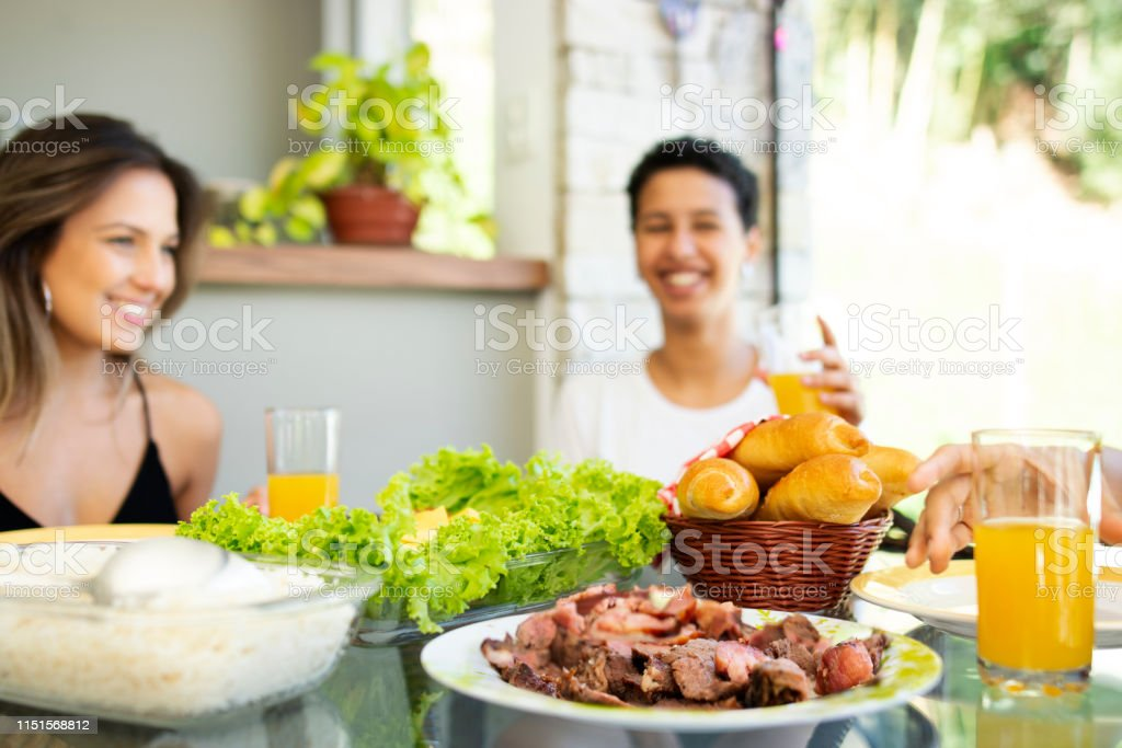 Friends eating meat