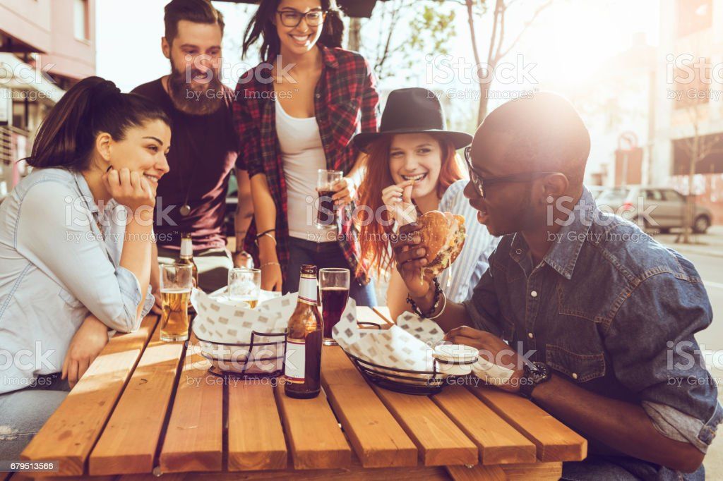 friends eating outdoors and having fun royalty-free stock photo