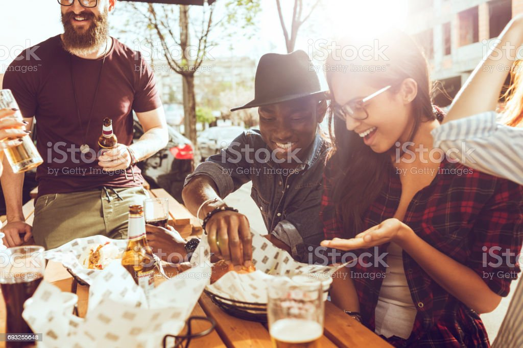 friends eating outdoors on a picnic stock photo