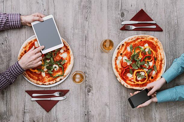 friends eating pizza together - bordsskick bildbanksfoton och bilder