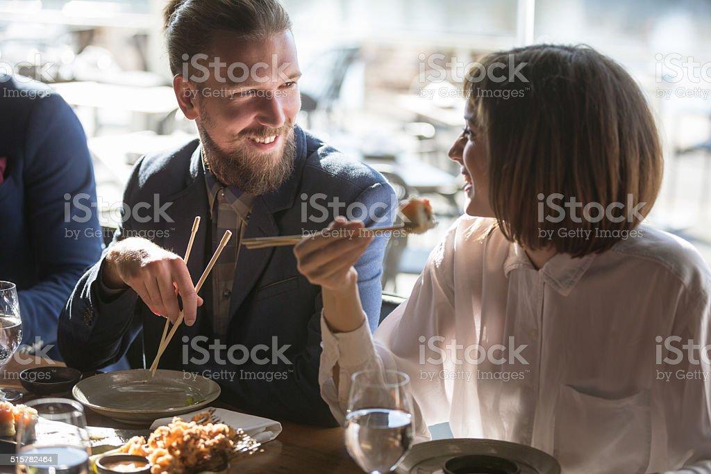 Friends eating sushi stock photo