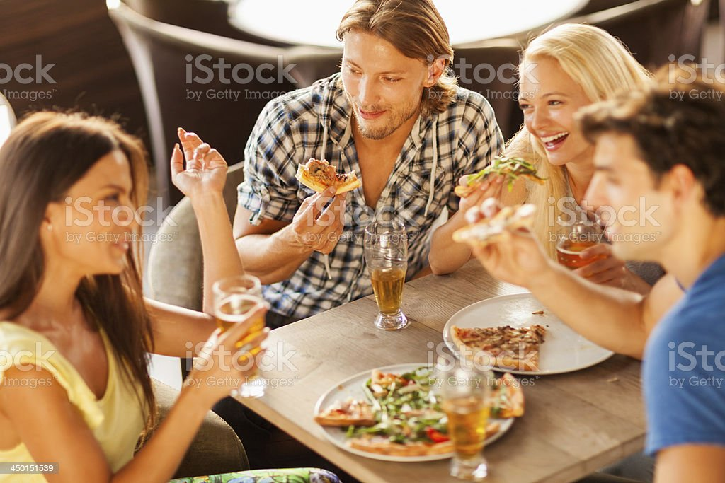 Friends eating together royalty-free stock photo
