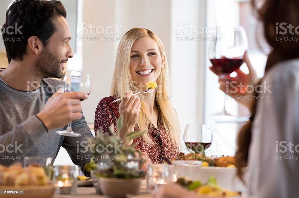Friends eating together stock photo