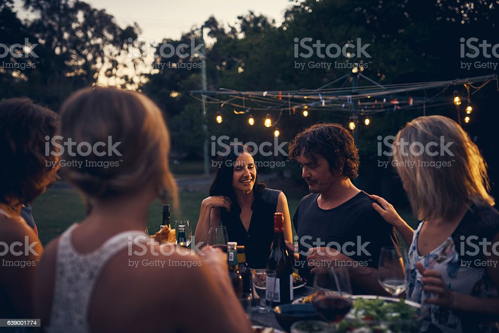 Friends elevate a great meal to sublime stock photo
