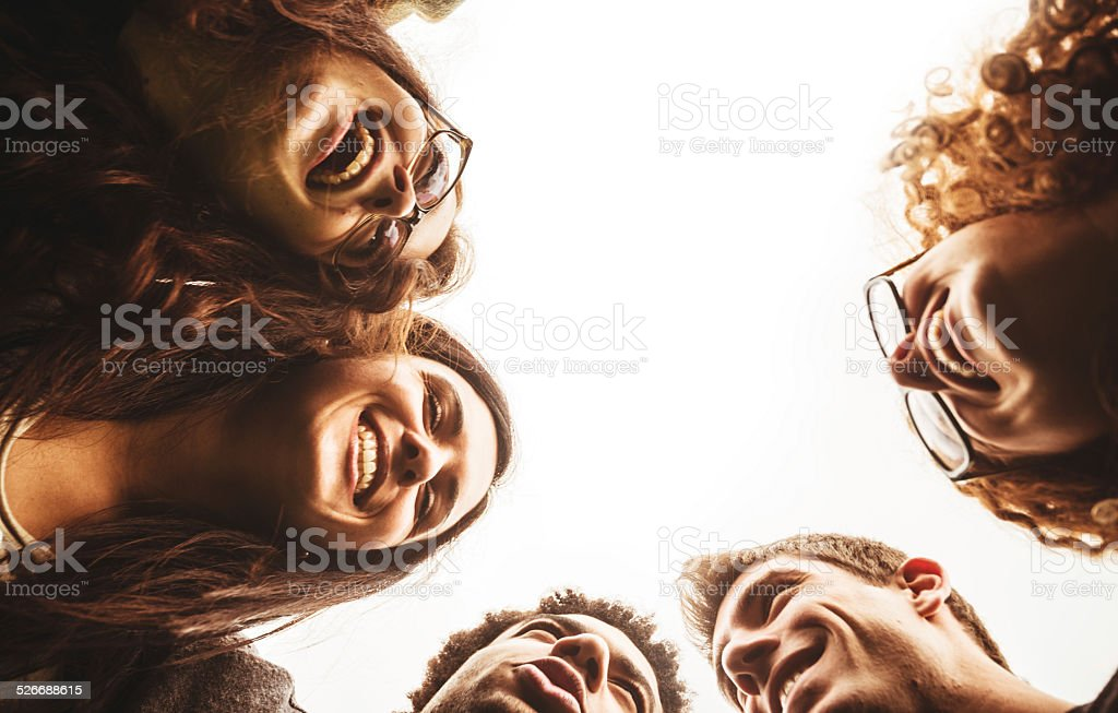 Friends embraced enjoy looking down stock photo