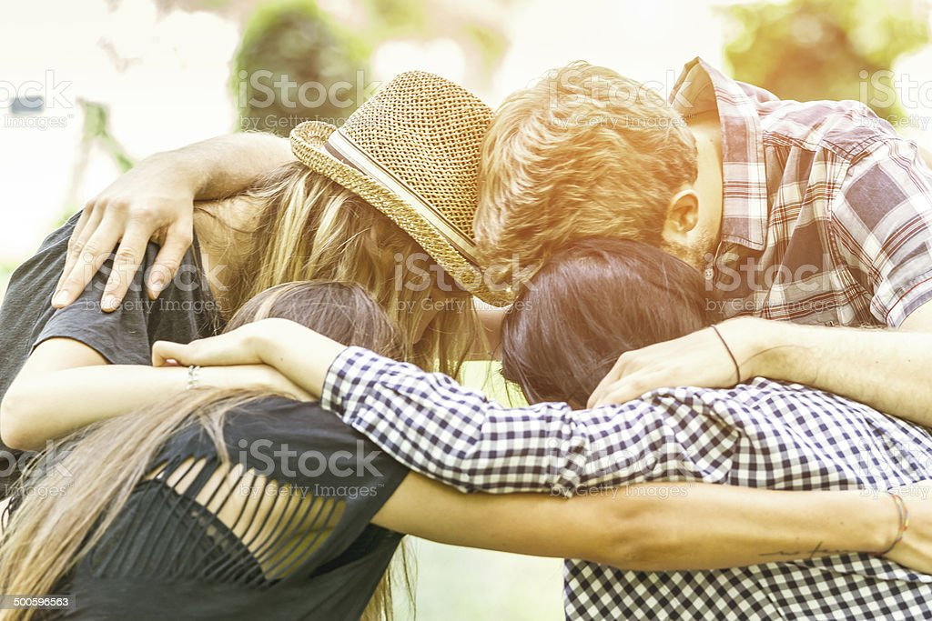 Friends embraced stock photo