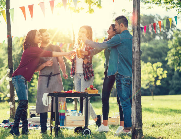 Friends enjoying a barbecue among nature stock photo