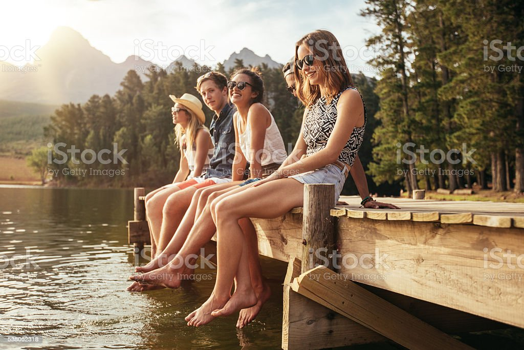 Friends enjoying a day at the lake stock photo