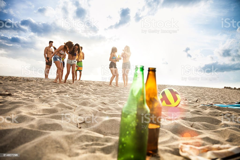 Friends enjoying a party on the beach stock photo
