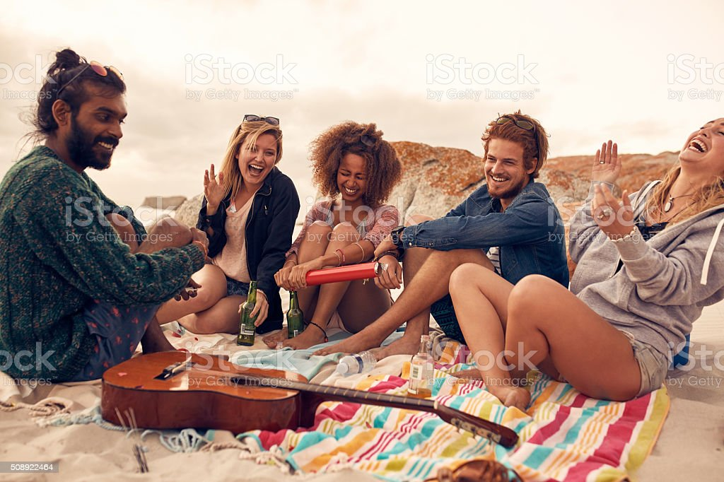 Friends enjoying at beach party stock photo